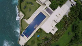 Flying over the house on the rock. Near the sea stock video footage