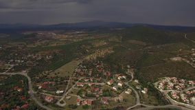 Flying over houses and green spaces in Trikorfo Beach, Greece stock video
