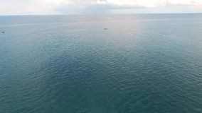 Flying over the Indian Ocean in Mauritiu. Alone boat in water stock video footage