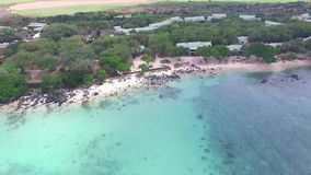 Flying over the Indian Ocean in Mauritius with luxury yacht and boats. Looking straight down to water. Albion area. stock video footage