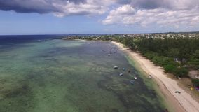 Flying over the Indian Ocean in Mauritius with luxury yacht and boats. Looking straight down to water. Albion area. stock footage