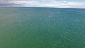 Flying over the irish sea at the coast of Wales - United Kingdom.  stock footage