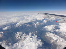 Flying Over the Italian Alps. Mountain range Royalty Free Stock Images