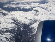 Flying over the Italian Alps. During a scheduled flight Stock Images
