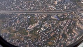 Flying over Kathmandu City in Nepal. View from Airplane stock video footage