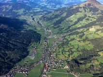 Flying over Kirchberg in a ballooning basket. Flying over Kirchberg in Tirol in a ballooning basket. The view over the village as seen in September 2015 stock photography