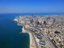 Flying Over Kuwait City On A Summer Day. Flying Over Kuwait City On A Blue Sky Summer Day royalty free stock photo