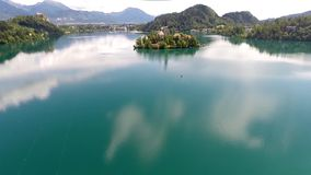 Flying over lake bled stock video
