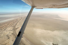 Flying Over Lake Eyre South Australia. When empty on a beautiful clear day Royalty Free Stock Photo