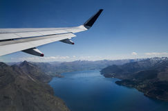 Flying over Lake Wakatipu Queenstown. Lake Wakatipu, Queenstown, New Zealand. An aerial view leaving Queenstown stock photos