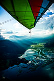 Flying over the lakes and mountains of Pokhara, Nepal in an ultralight aircraft Royalty Free Stock Image