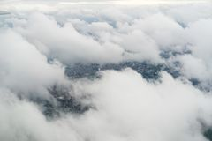 Flying over London on a cloudy day royalty free stock photography