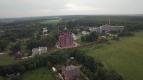 Flying over Lukino Village with Cathedral of Ascension. Flying over the private houses and Cathedral of Ascension in Lukino Village, Russia stock video
