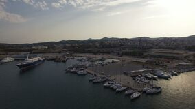 Flight over Lavrio marina and port. Yachts, sail boats, cruise ships. Flying over marina, port, yacht parking of Lavrio coastal city. Yachts, sail boats, cruise stock video footage