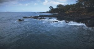 Flying over the Maui Coastline. 4K UHD establishing shot stock video footage