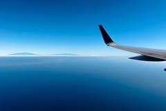 Flying Over Mauna Kea and Mauna Loa. Flying pass Hawaii - Big Island, with its two big volcanoes - Mauna Kea and Mauna Loa rising high above clouds Stock Photos