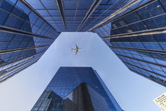 Flying over modern Buildings. A plane flying over the modern blue cubic buildings located at La defense, Paris, France Stock Photos