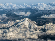 Flying over mont blanc in the alps. With Clouds Stock Photos