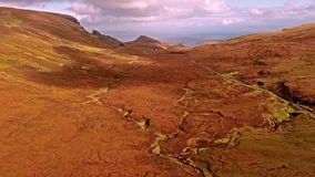Flying over the mountain pass road on the top of Quiraing from Staffin to Uig - Isle of Skye, Scotland. United Kingdom stock video footage