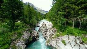 Flying over mountain river. (soca, slovenia stock video
