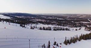 Flying over mountain, winter landscape, skiresort stock video