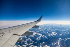 Flying over the mountains Royalty Free Stock Photo