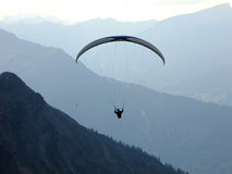 Flying over the Mountains. Paragliding through the high Mountains of Nebelhorn in German Alps Royalty Free Stock Image