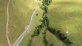 Flying over the mountains and road stock footage