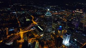 Flying over night Atlanta central business district. view of Suntrust Plaza, freeway traffic lights. real time. Flying over night Atlanta central business stock video