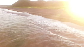 Flying over the ocean. Sea waves. Sunset Pacific Ocean. People in the wild stock footage