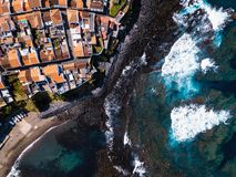 Flying over the ocean surf on the reefs coast in Maia city of San Miguel island, Azores. Flying over the ocean surf on the reefs coast in Maia city of San royalty free stock image
