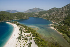 Flying over Olu Deniz. Paragliding over Olu Deniz in Turkey Stock Photos