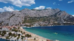 Flying over Omis town, Dalmatian Coast, Croatia stock video footage