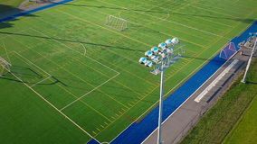 Flying Over an Outdoor Synthetic Football Field stock video footage