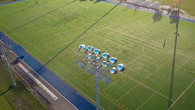 Flying Over an Outdoor Synthetic Football Field stock video
