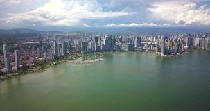 Aerial Drone view of Panama City skycrapers with waterfront. Flying over Panama City skycrapers with waterfront stock video