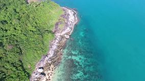 Flying over paradise island rocks and blue water. HD aerial slowmotion. Thailand stock footage