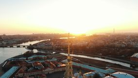 Flying over the Peter and Paul Fortress near the angel at sunset. The historical center of St. Petersburg. Epic aerial shooting over the Peter and Paul Fortress stock video