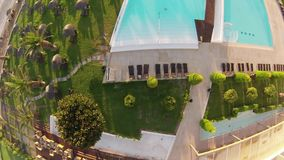 Flying over a pool Royalty Free Stock Photos