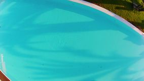 Flying over a pool stock footage