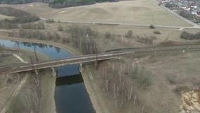 Flying over the railway bridge. Railway. Railway bridge over the river stock video footage
