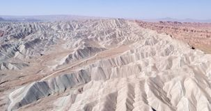 Flying over the red, colorful, rainbow mountains, covered with unique patterns, Iran. Aerial photography. 4k stock footage