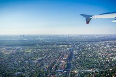 Flying over residential neighborhoods, Bucharest skyline in the background royalty free stock photo