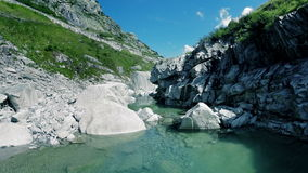 Flying over river canyon landscape stone rocks background stock footage