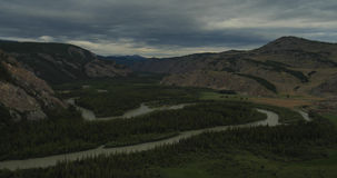 Flying over the river in cloudy weather. stock footage