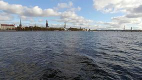 Flying over river Daugava, view to the old town Riga, Latvia stock footage