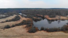 Flying over the river in early spring stock footage