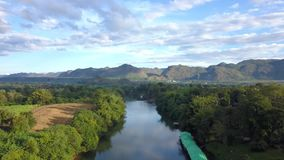 Flying over the river ,mountains and trees. Aerial View, Flying over the river ,mountains and trees with beautiful clouds and sky,Landscape nature with aerial stock footage