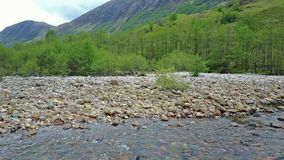 Flying over the river Nevis stock video