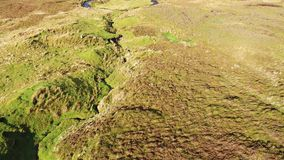 Flying over the River Rha between Staffin and Uig on the Isle of Skye , Scotland. Flying over the beautiful winding River Rha between Staffin and Uig on the Isle stock footage